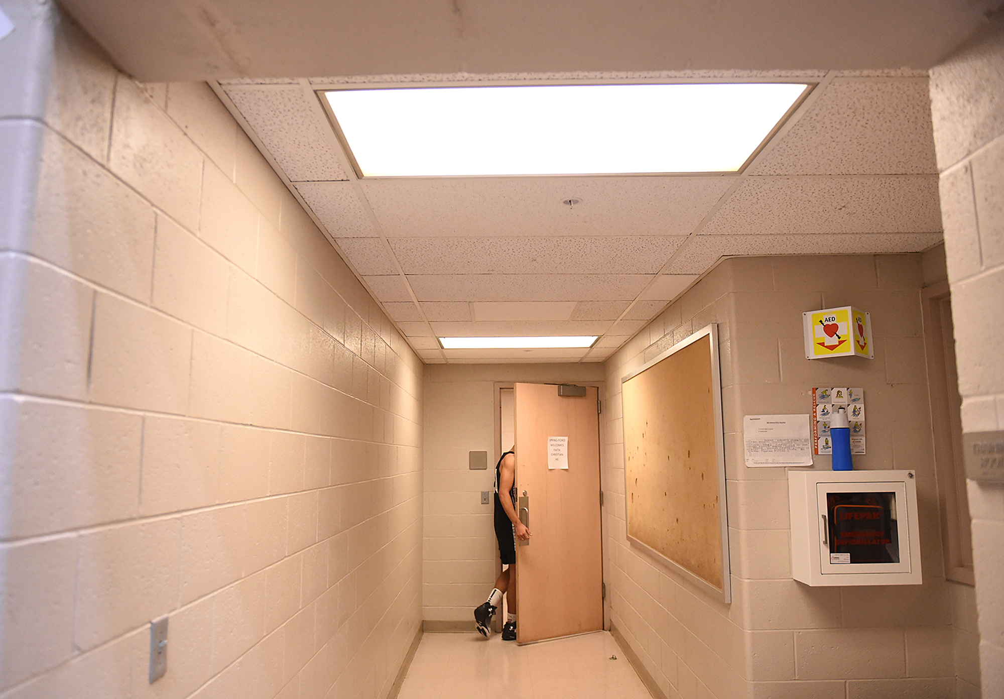 Faith Christian's Charles Ervin (20) is the last to the locker room after pausing to take a moment to himself after a 67-58 loss to Girard College during their PIAA Class A boys basketball semifinal game at Spring-Ford High School in Royersford on Monday, March 20, 2017. The game eliminates Faith Christian from state playoffs.
