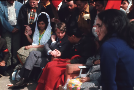 Robert Kennedy shakes hands with Cesar Chavez as Dolores Huerta looks on