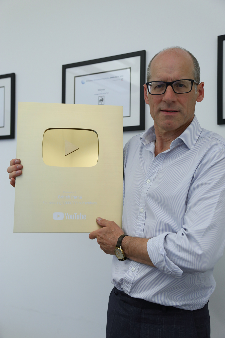 Alastair White, CEO of British Movietone, with YouTube Gold Creator Award