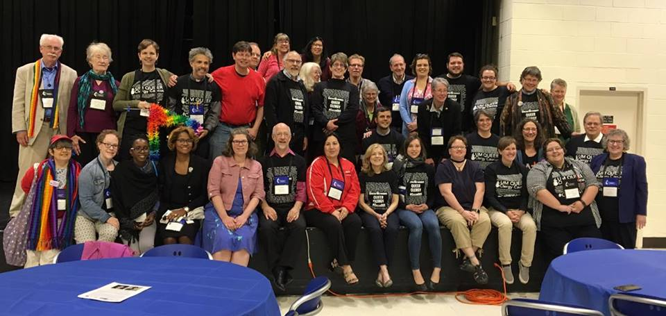 Steering committee members, queer clergy, and others gathered after the MIND lunch at the Annual Conference session, June 9.