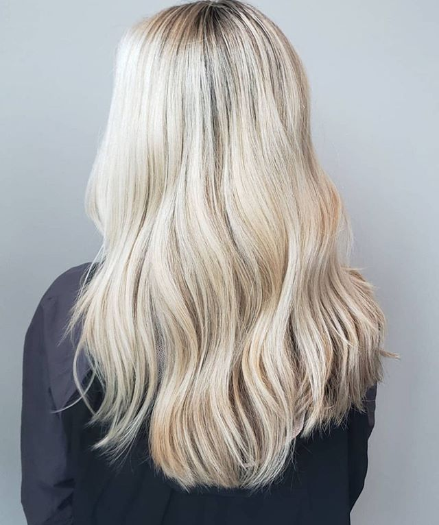 The perfect platinum. 👌🏼 To keep your blonde looking it's brightest, make sure to use a purple shampoo to keep tones cool. We are happy to help match you to what will work best for you! ✨ Color by Abbie. #aristagirl #kchairstylist #leawood #kchair