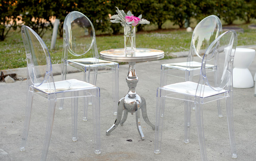 Rental Furniture Pictured: Armless Ghost Chairs, Aluminum Table, Tall Block Vase, Fresh Flowers.