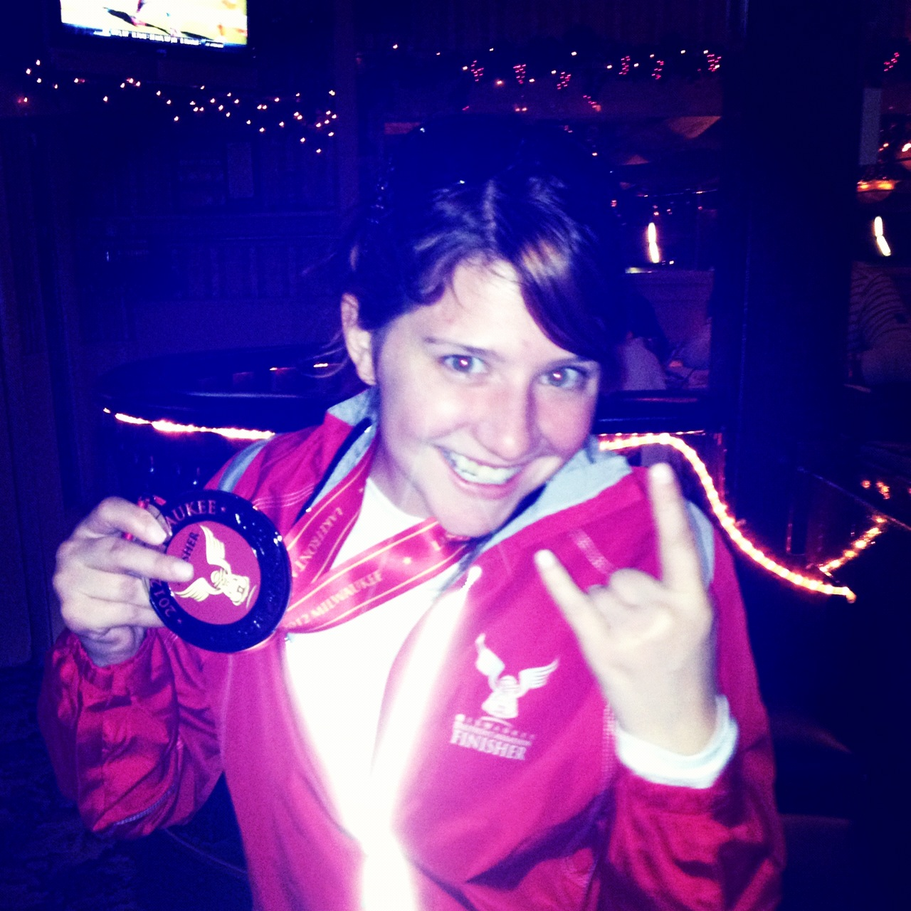 Finisher medal and jacket pose