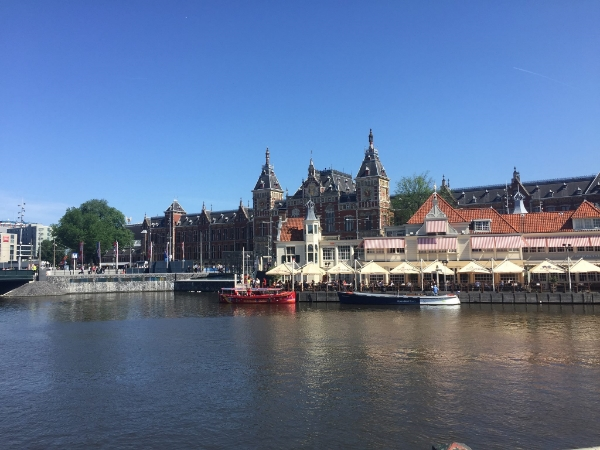 One of the many canals in Amsterdam, with some of the city's stately architecture behind