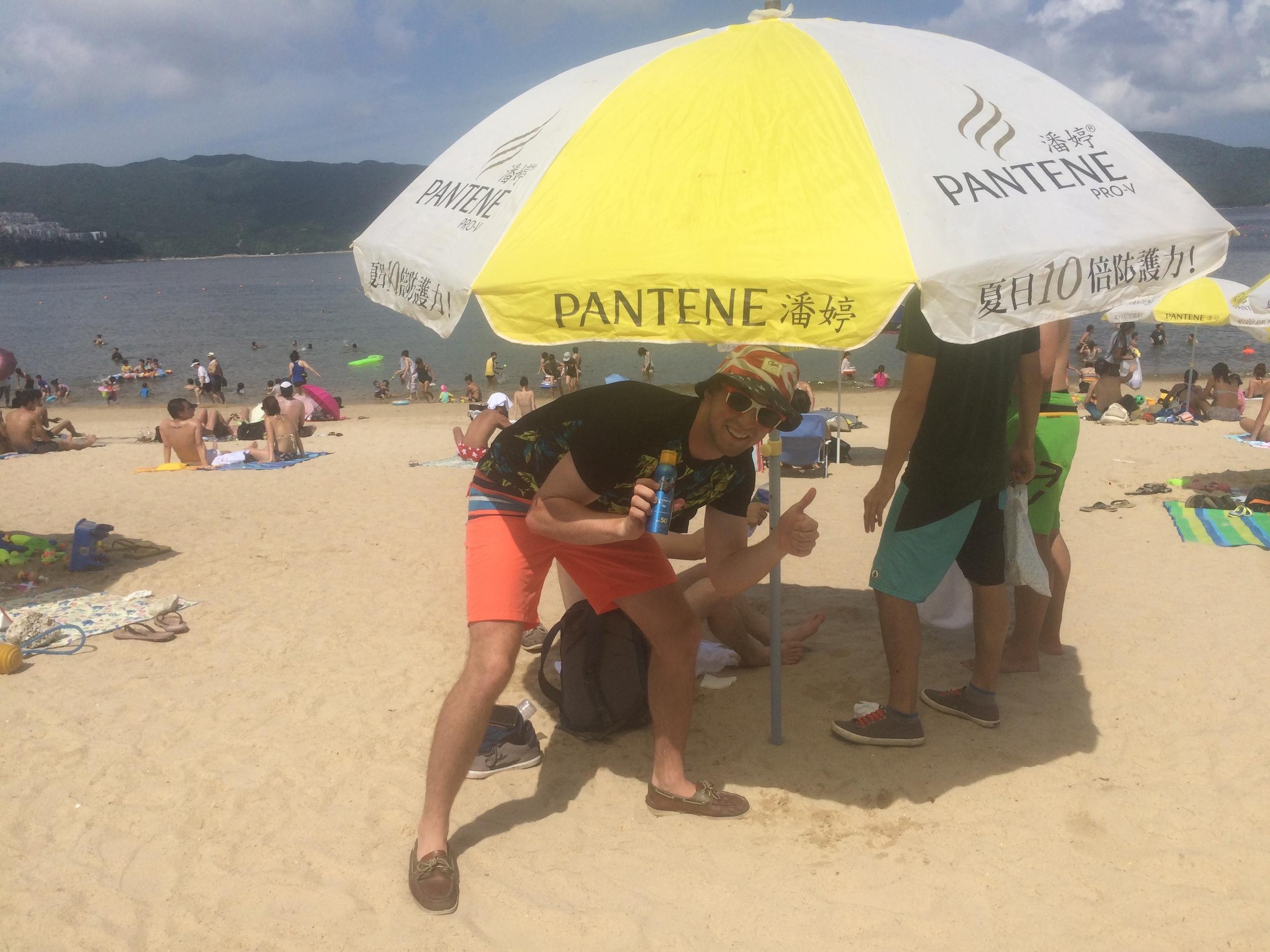 The Dins in full tourist attire on Stanley's beach