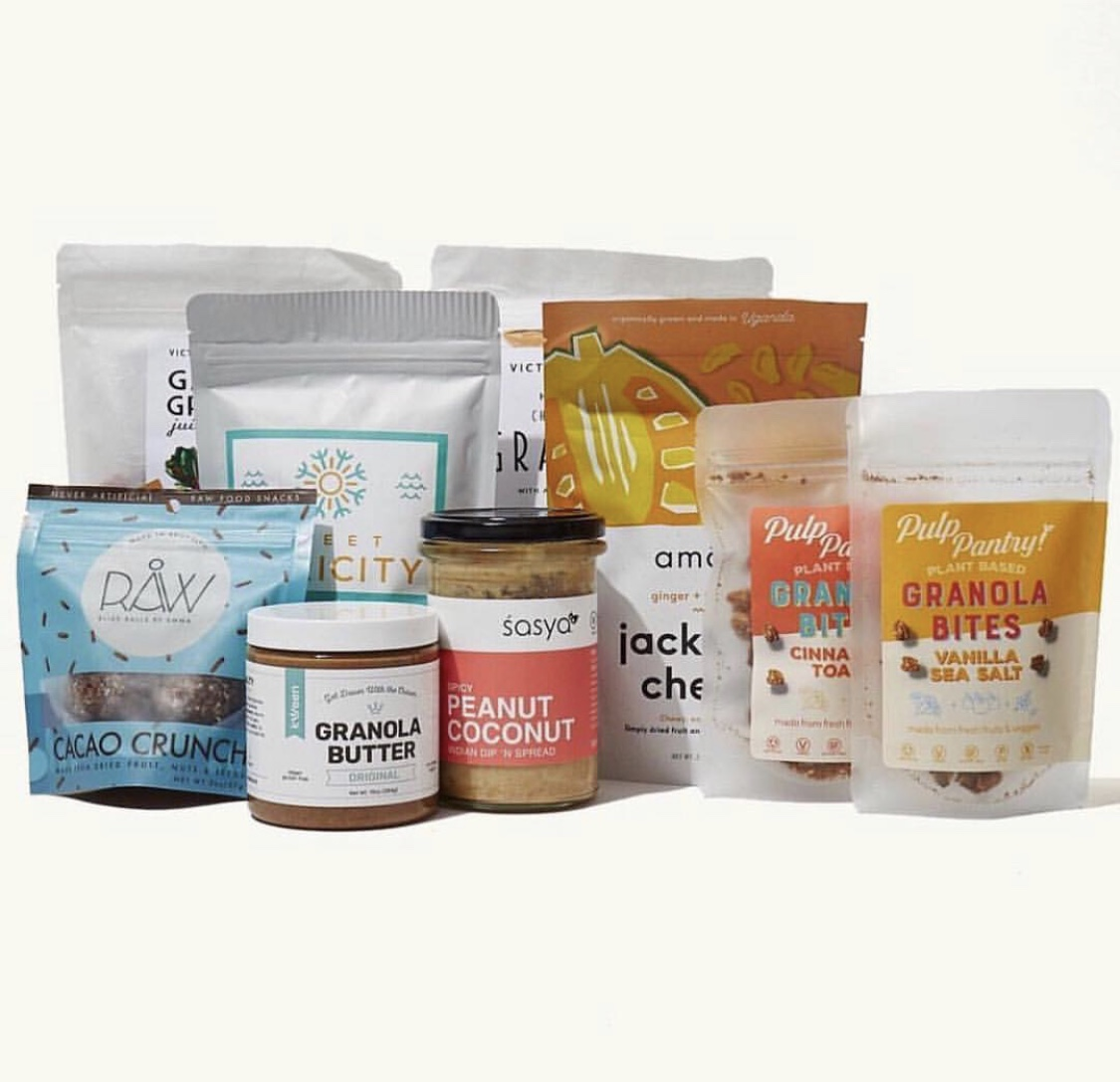 Garden Granola and our Cherry Almond Hemp Granuesli can be seen in the back row with six other snacks all picked by Jessica Young in collaboration with Bon Appé
