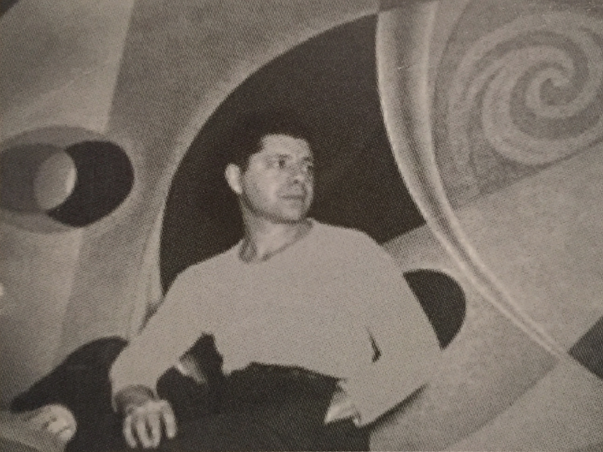 Seymour Fogel in front of his mural, Creation.                           Source | The Abstract Art of Seymour Fogel: An Atavistic Vision , Hilton Head Island, SC: Time Again Publications (199-?).
