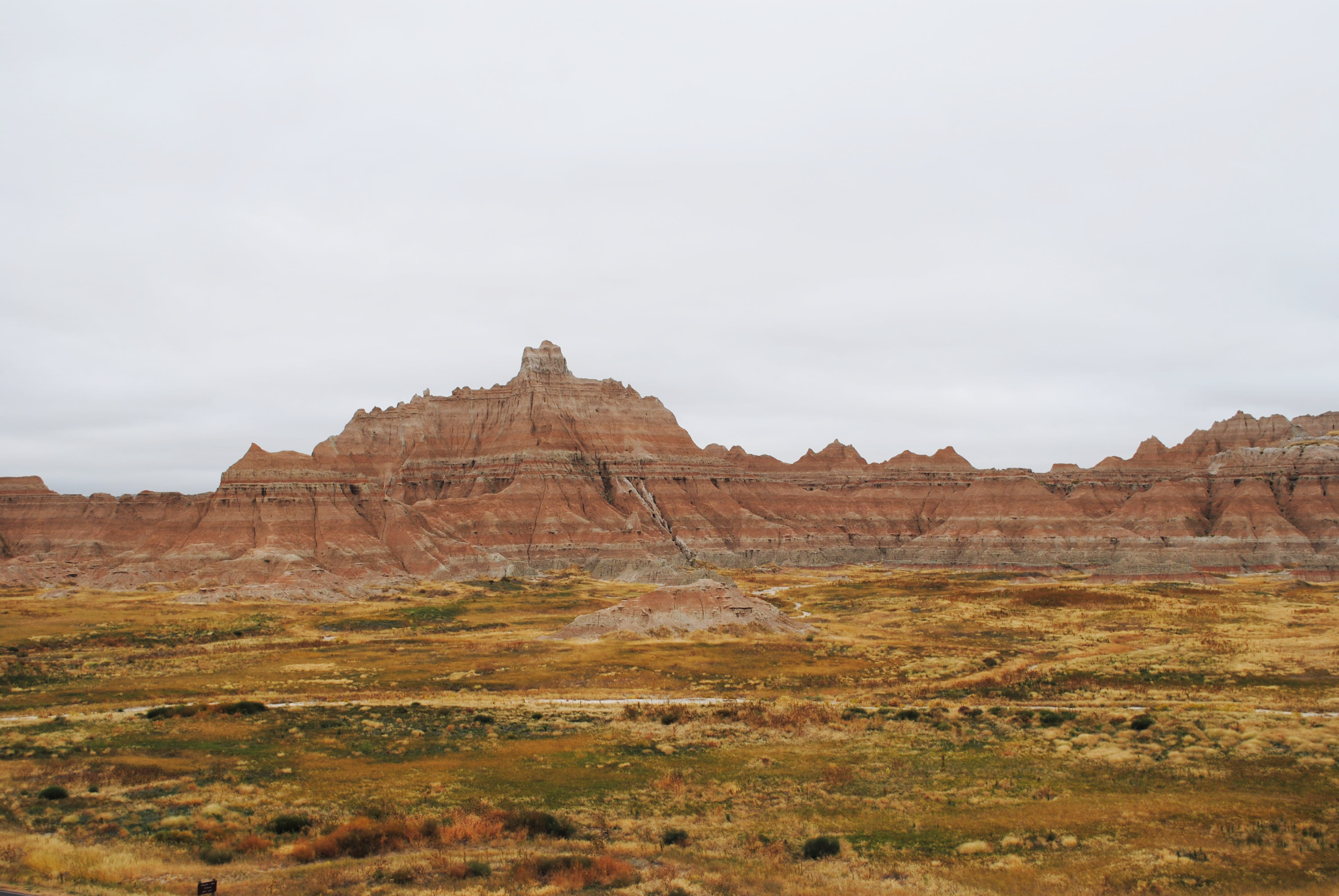 HWY 240 Loop Road weaves through the striated features of the Badlands formations and the mixed grass prairie.