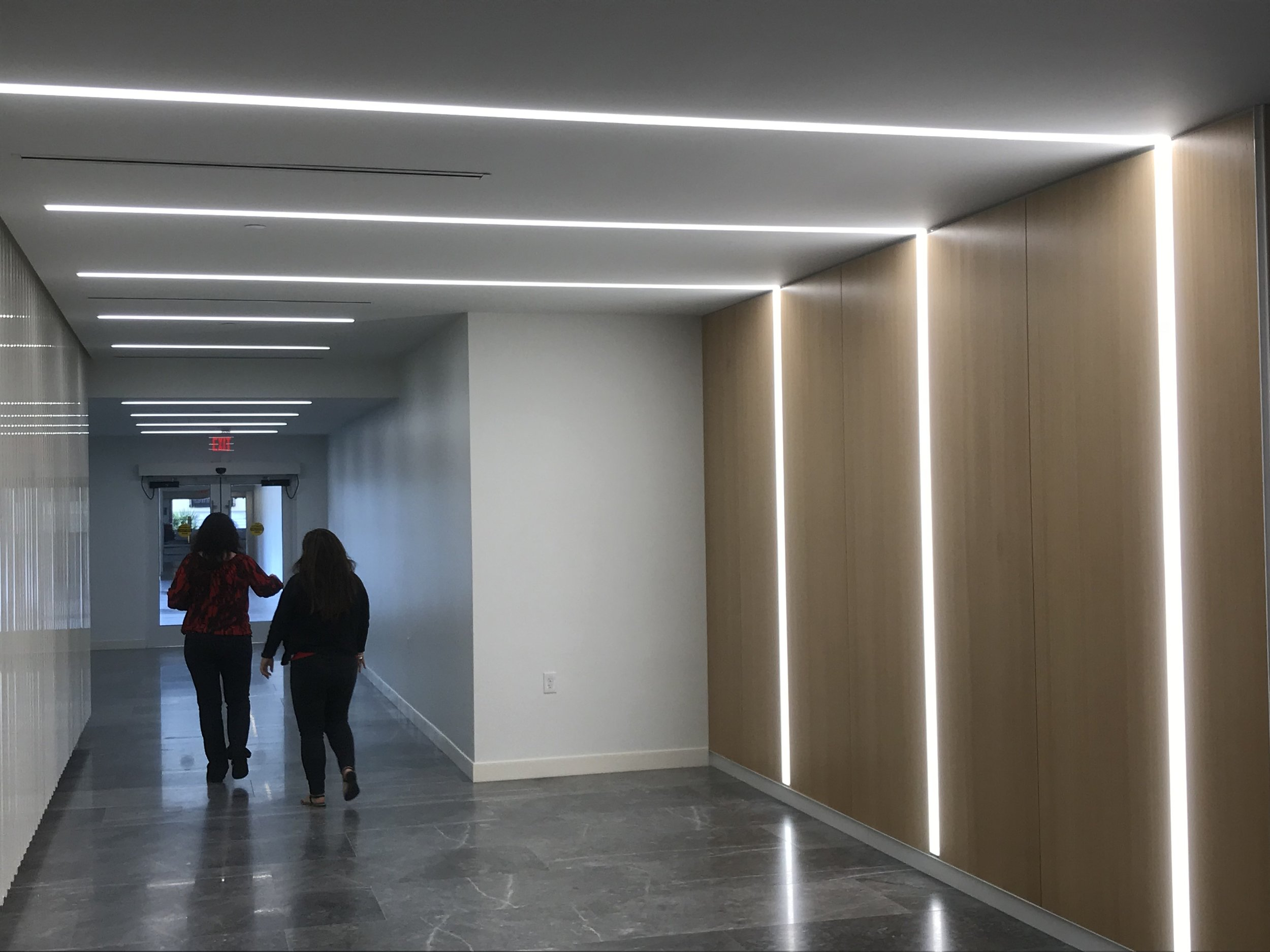 Esperante Corporate Center, 222 Lakeview Avenue in West Palm Beach, Lobby and reception area was remodeled by Gensler Architects. Starfire Lighting's linear ceiling and wall fixtures was used.