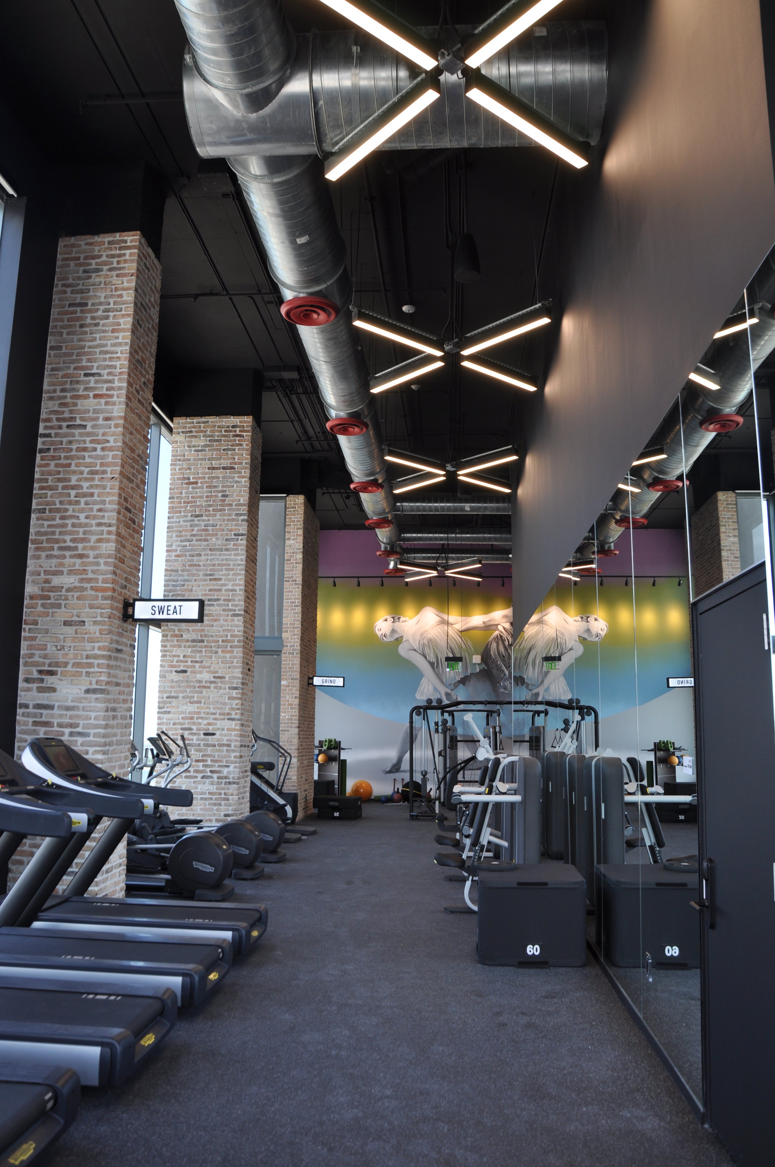 """Horton Lees Brogden Lighting Design used the VersaLux LED Pendants from Starfire in a """"X"""" formation at the Vice Fitness Center  in Miami"""