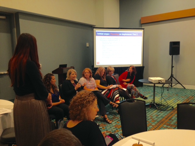 Kippi Jordan and Aimee Evans, as part of a state-­‐wide panel, discussed challenges and successes with supporting teachers' implementation of effective classroom positive behavior practices within an RTI2-­‐B framework.