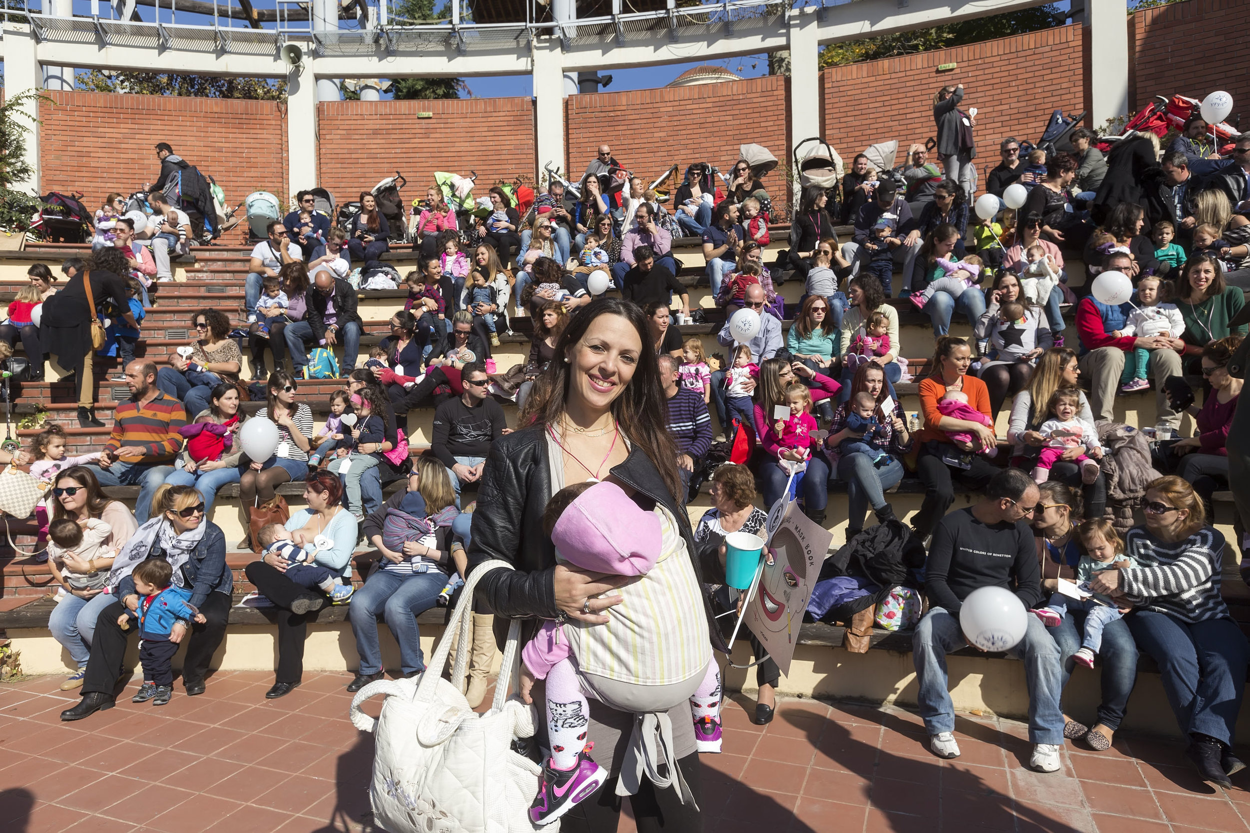Thessaloniki, Greece, November 1 2015: Mother breastfeeding her baby on the 6th Nationwide public breastfeeding in celebration of World Breastfeeding Week.