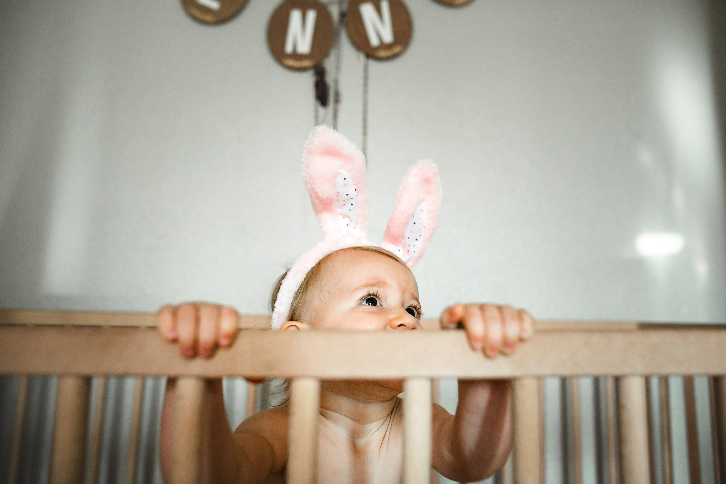baby plays in crib wearing diaper and bunny ears 3-(ZF-0126-04493-1-010).jpg