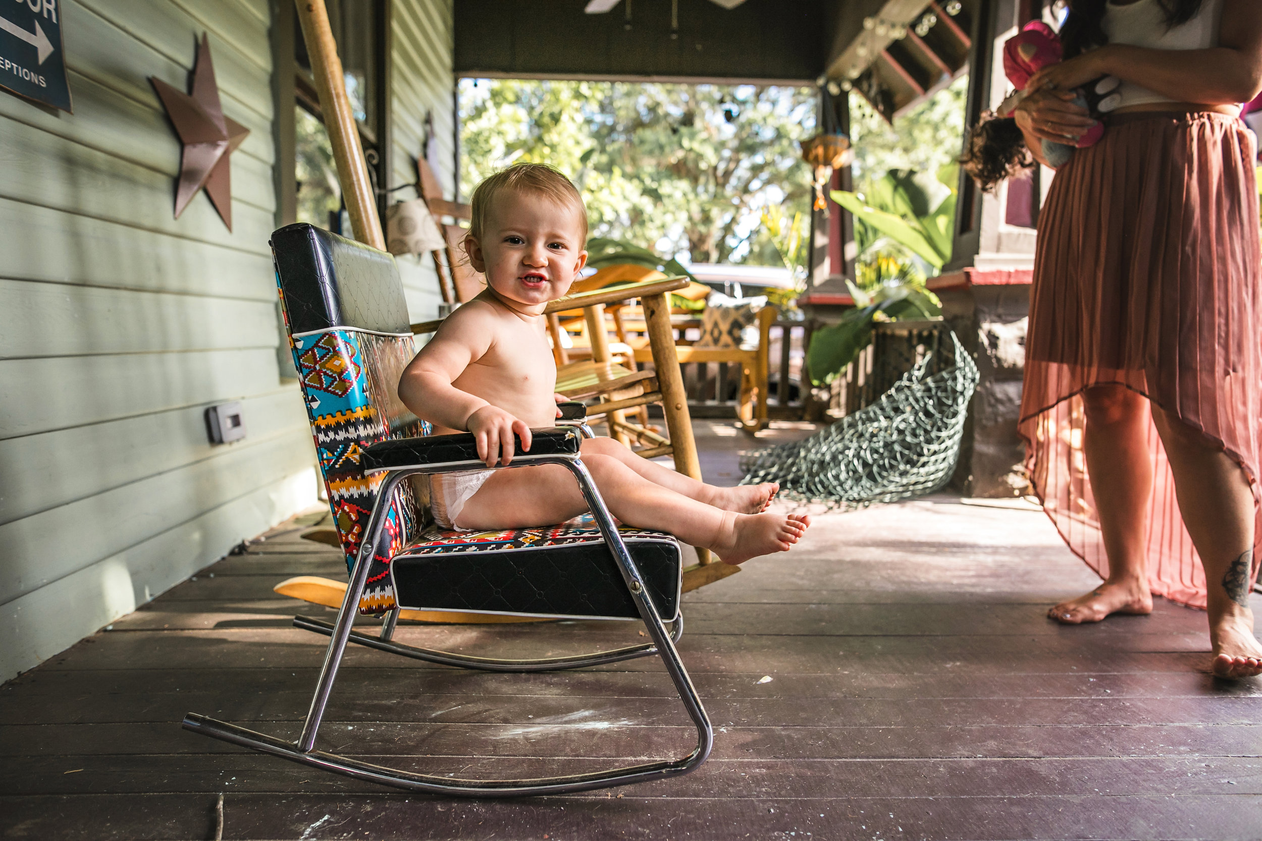 baby sits in rocking chair on front porch wearing a diaper 2-(ZF-0126-04493-1-032).jpg
