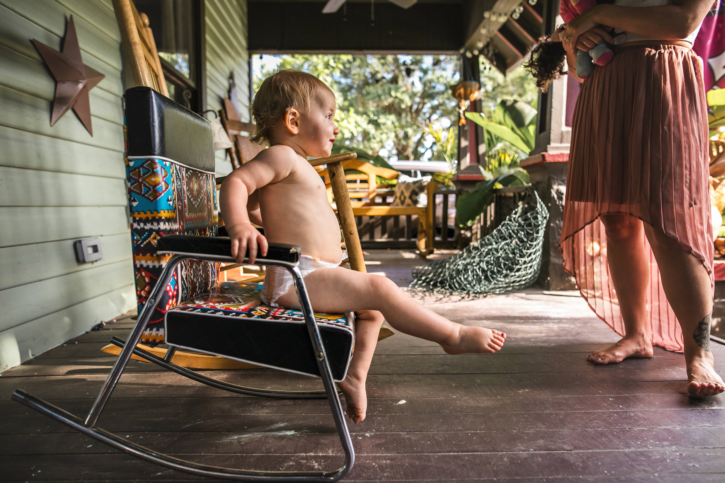 baby sits in rocking chair on front porch wearing a diaper 4-(ZF-0126-04493-1-033).jpg