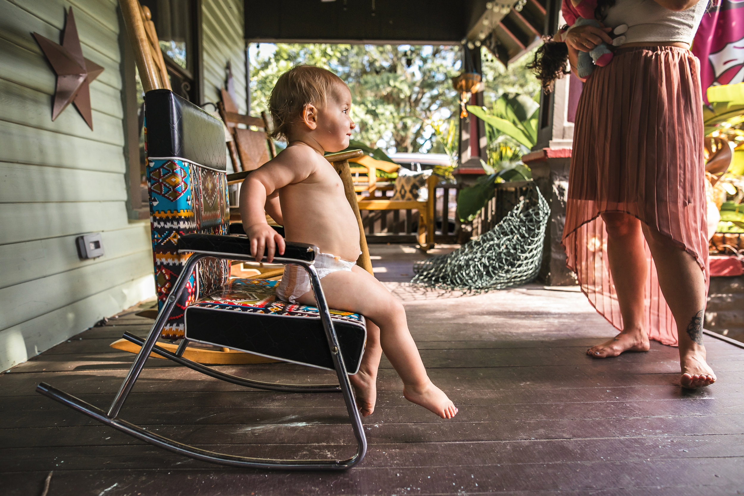 baby sits in rocking chair on front porch wearing a diaper 3-(ZF-0126-04493-1-034).jpg
