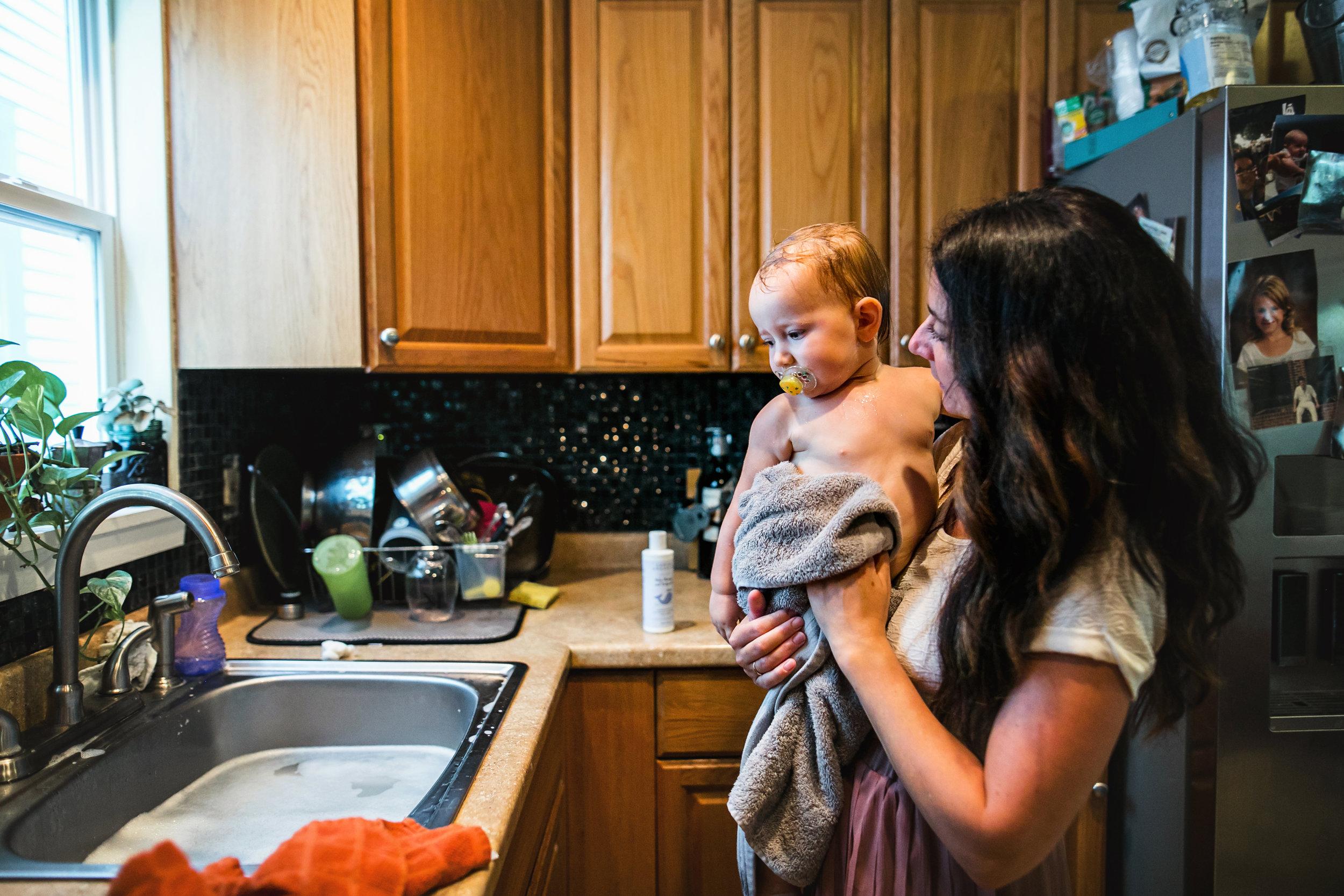 mom dries baby after bath in kitchen sink-(ZF-0126-04493-1-046).jpg