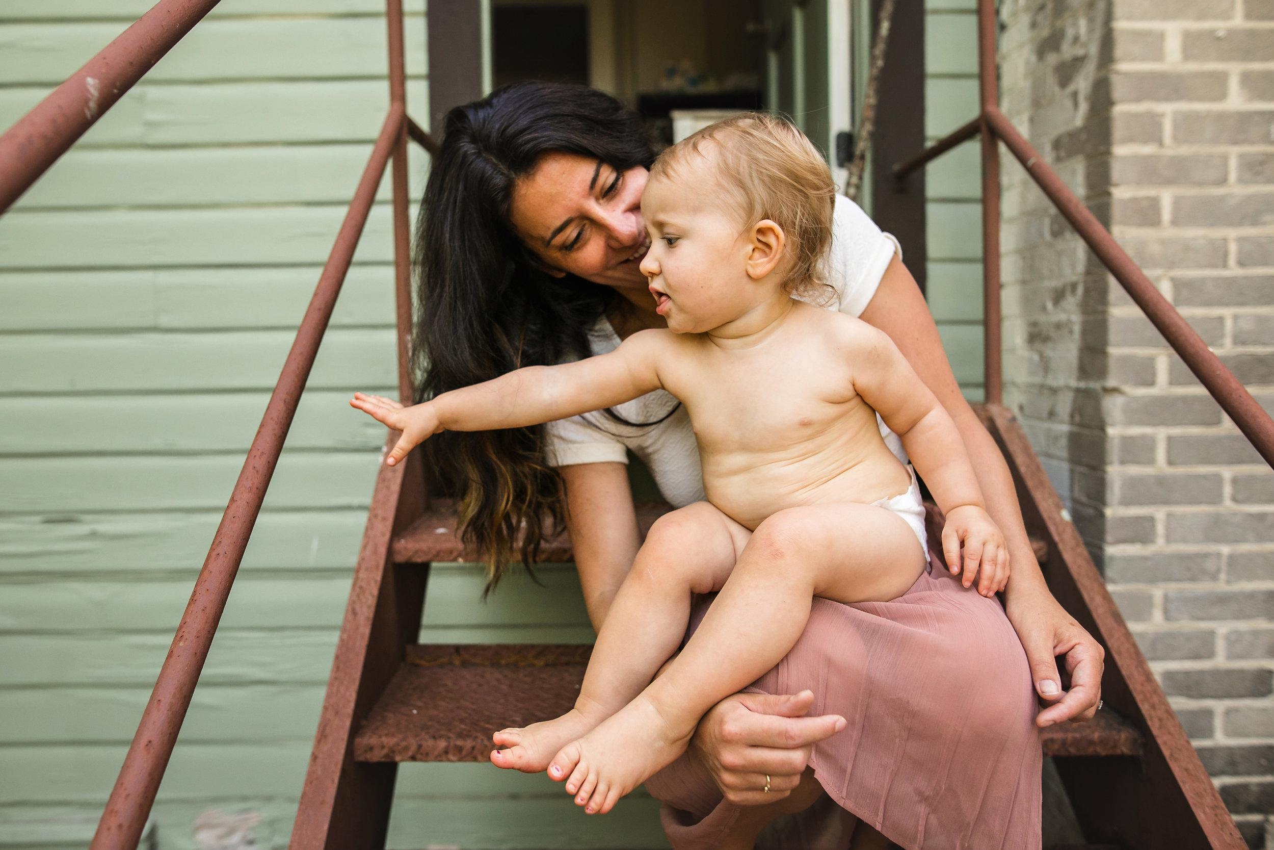 baby sits on moms lap wearing diaper 2-(ZF-0126-04493-1-019).jpg