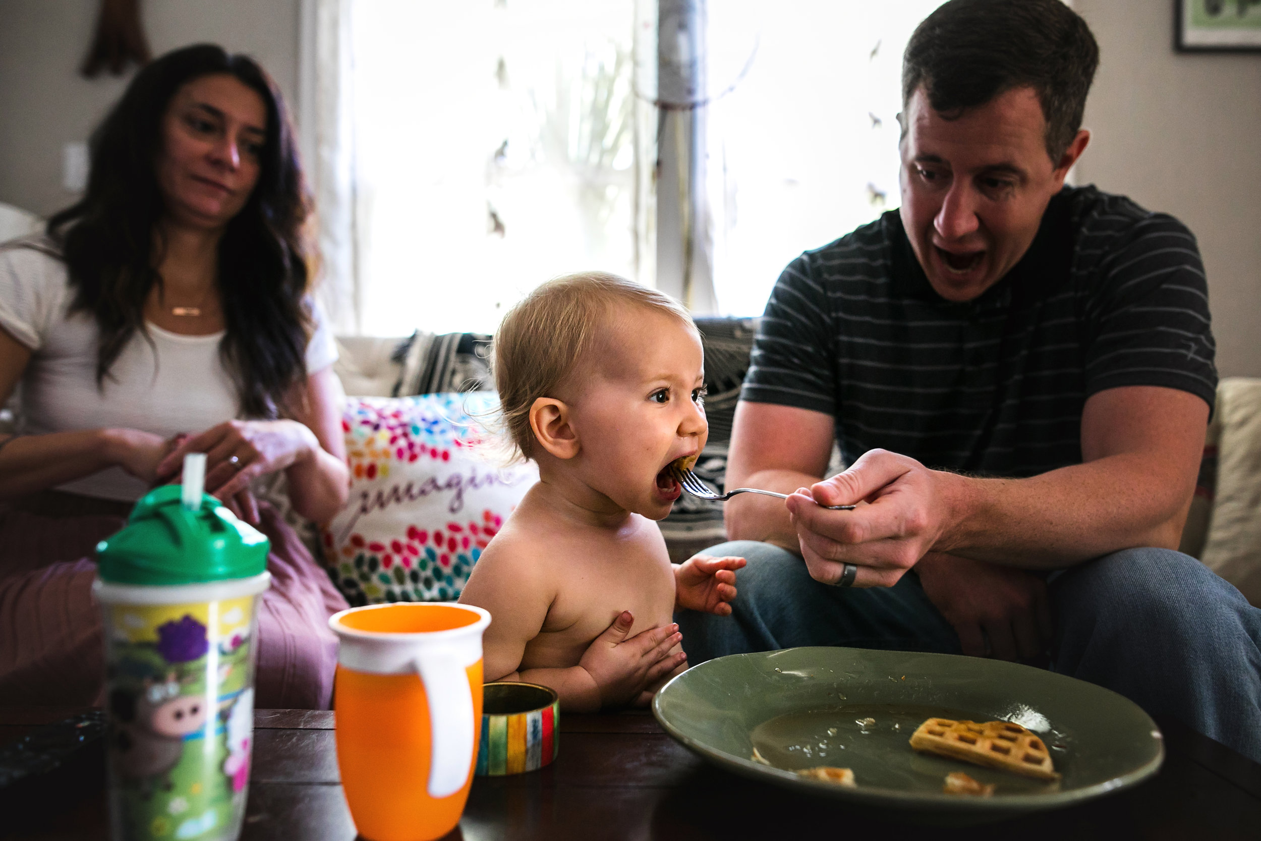 dad feeds baby waffles in the living room-(ZF-0126-04493-1-030).jpg