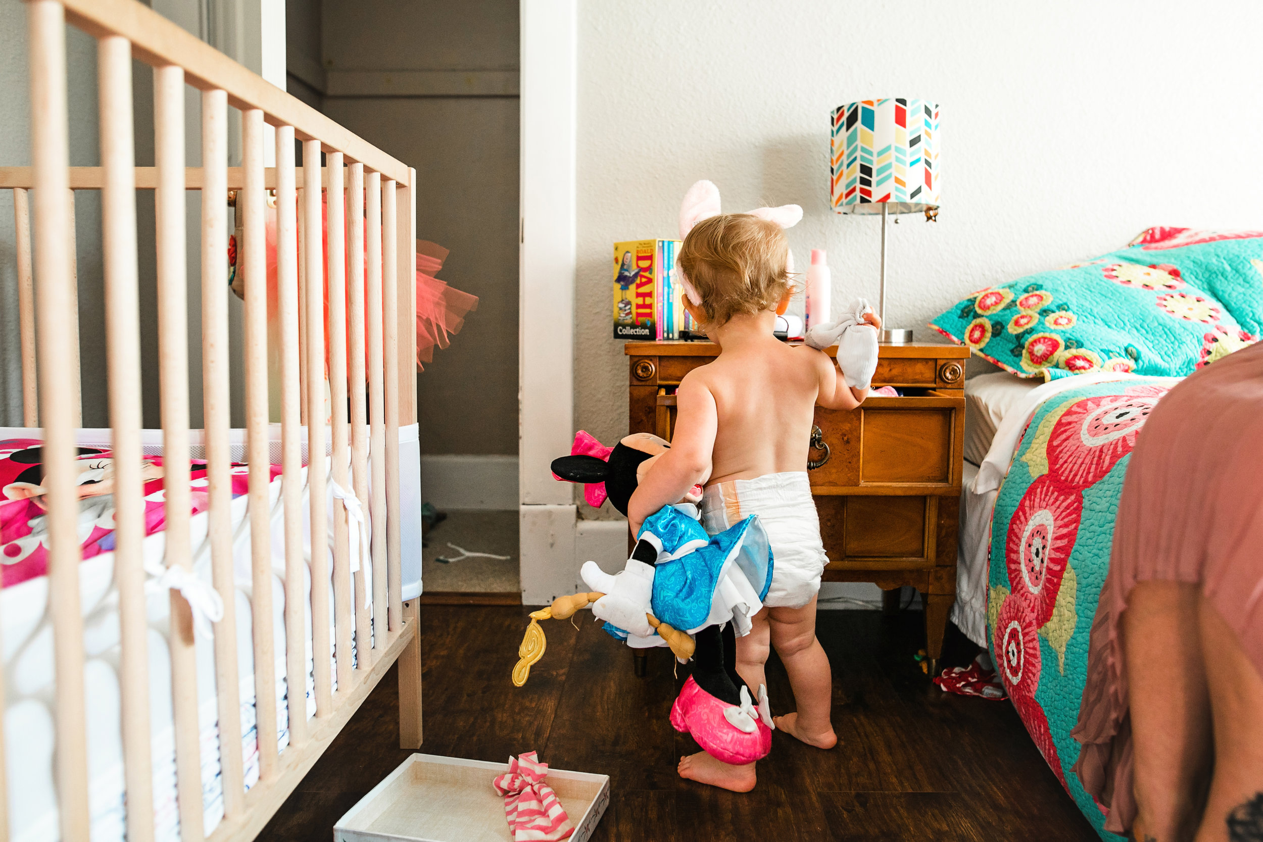 baby digs through nightstand drawer wearing diaper-(ZF-0126-04493-1-007).jpg