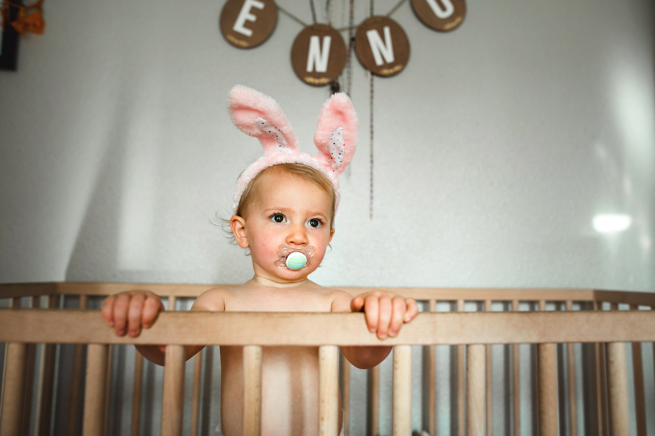 baby plays in crib wearing diaper and bunny ears 6-(ZF-0126-04493-1-013).jpg