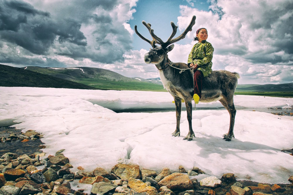 Tsaatan with reindeer by Khasar Sandag