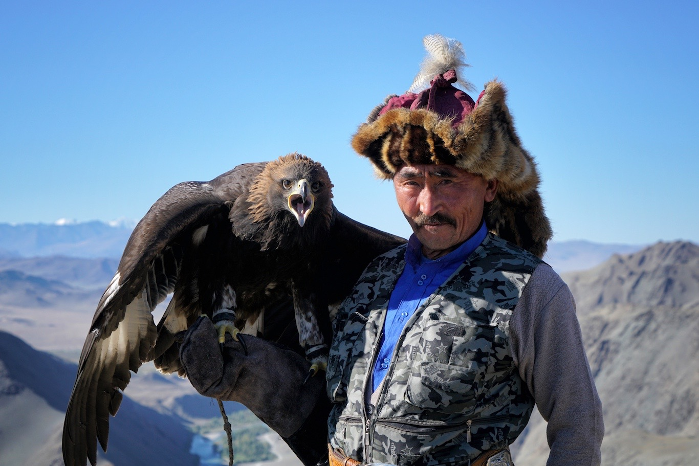 Kazakh Eagle Hunter-Haizem with is Golden Eagle, champion of 2012