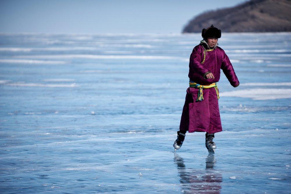 Local herder skating on ice by Khasar Sandag