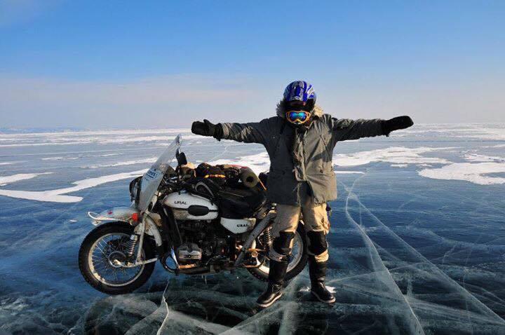 Motorcyclist on Khuvsgul lake by Khasar Sandag