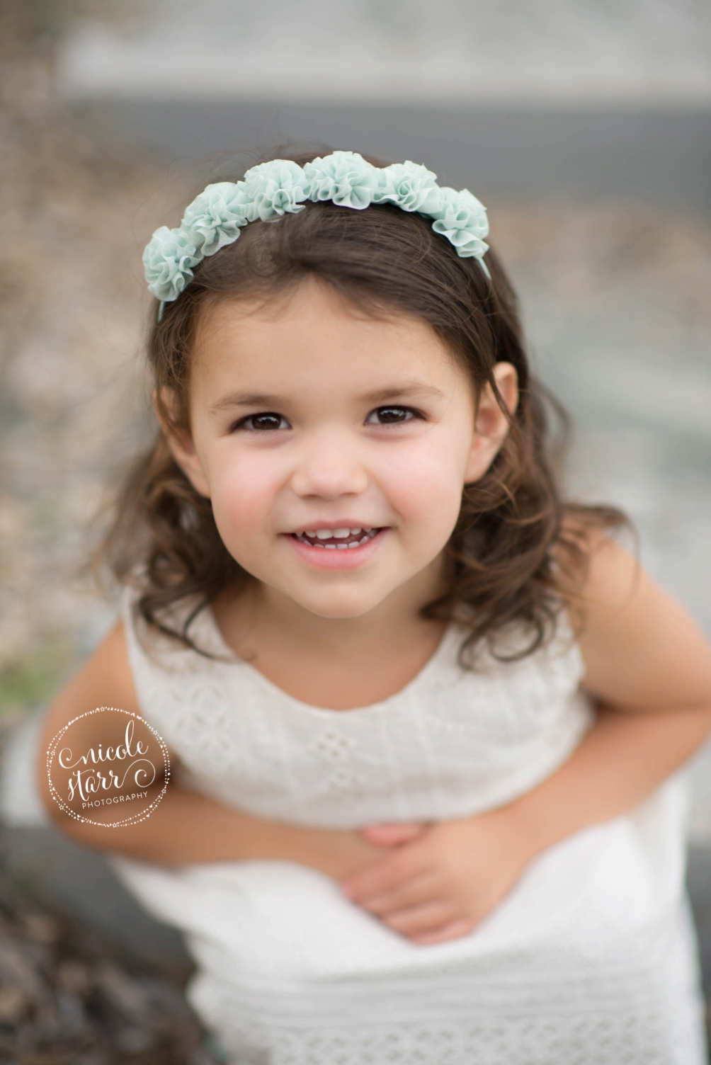 little girl with headband and white dress
