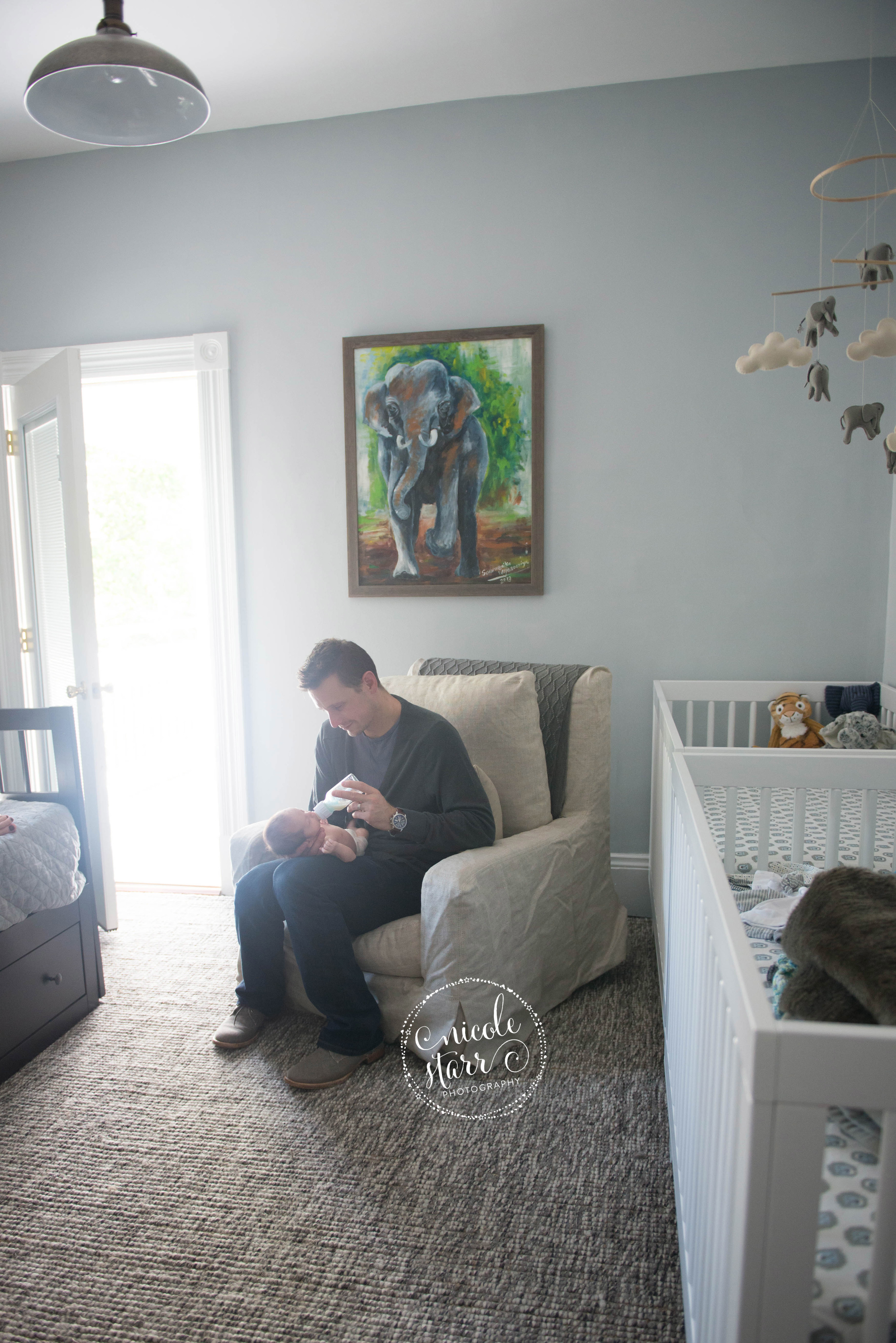 father and baby in nursery lifestyle session