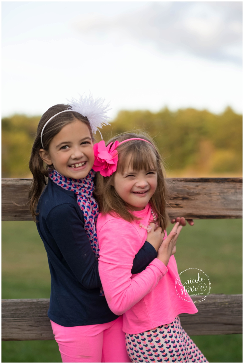 Twin sisters, one with down syndrome.
