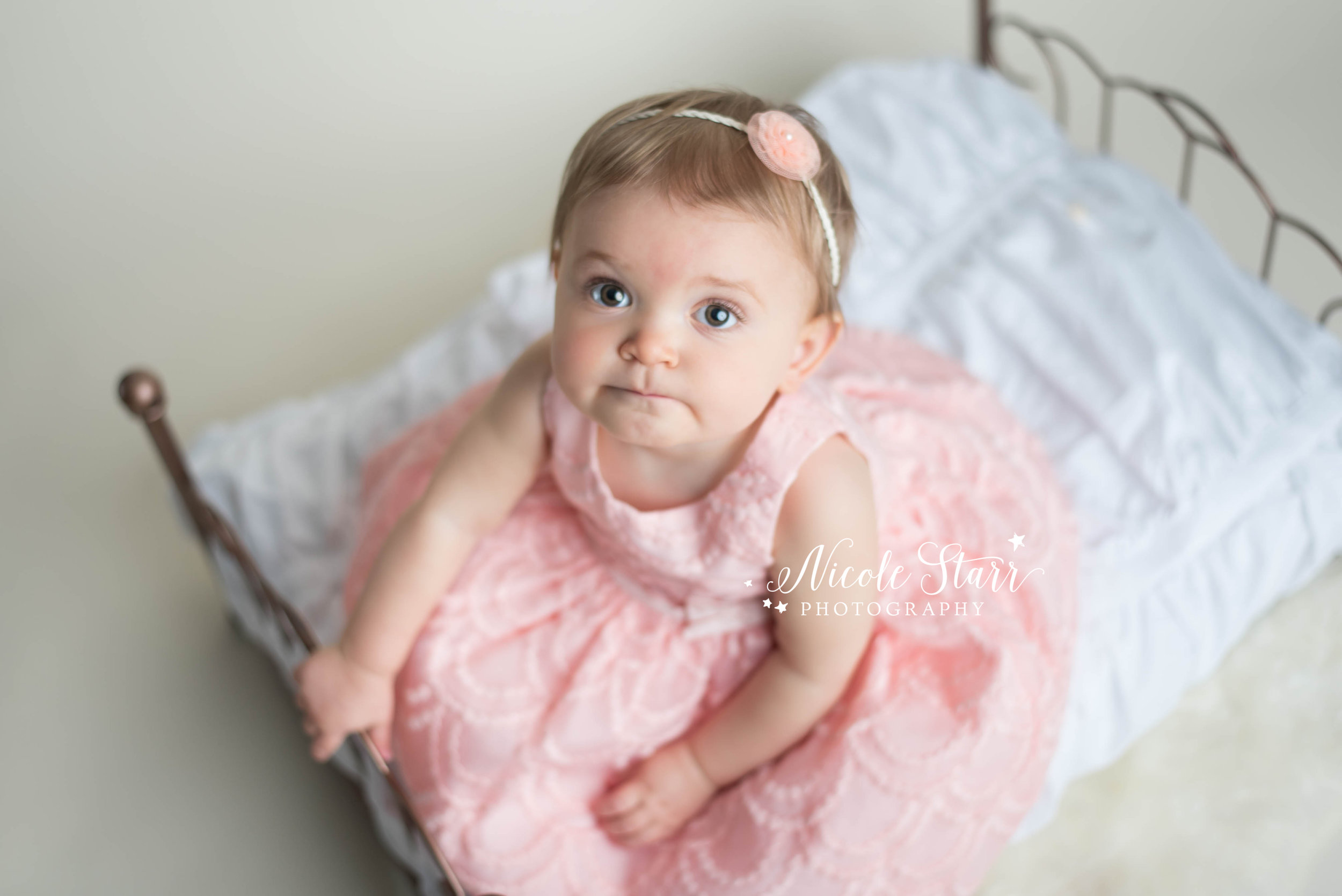 whimsical pink and white flower backdrop for baby's first birthday photo session in saratoga springs