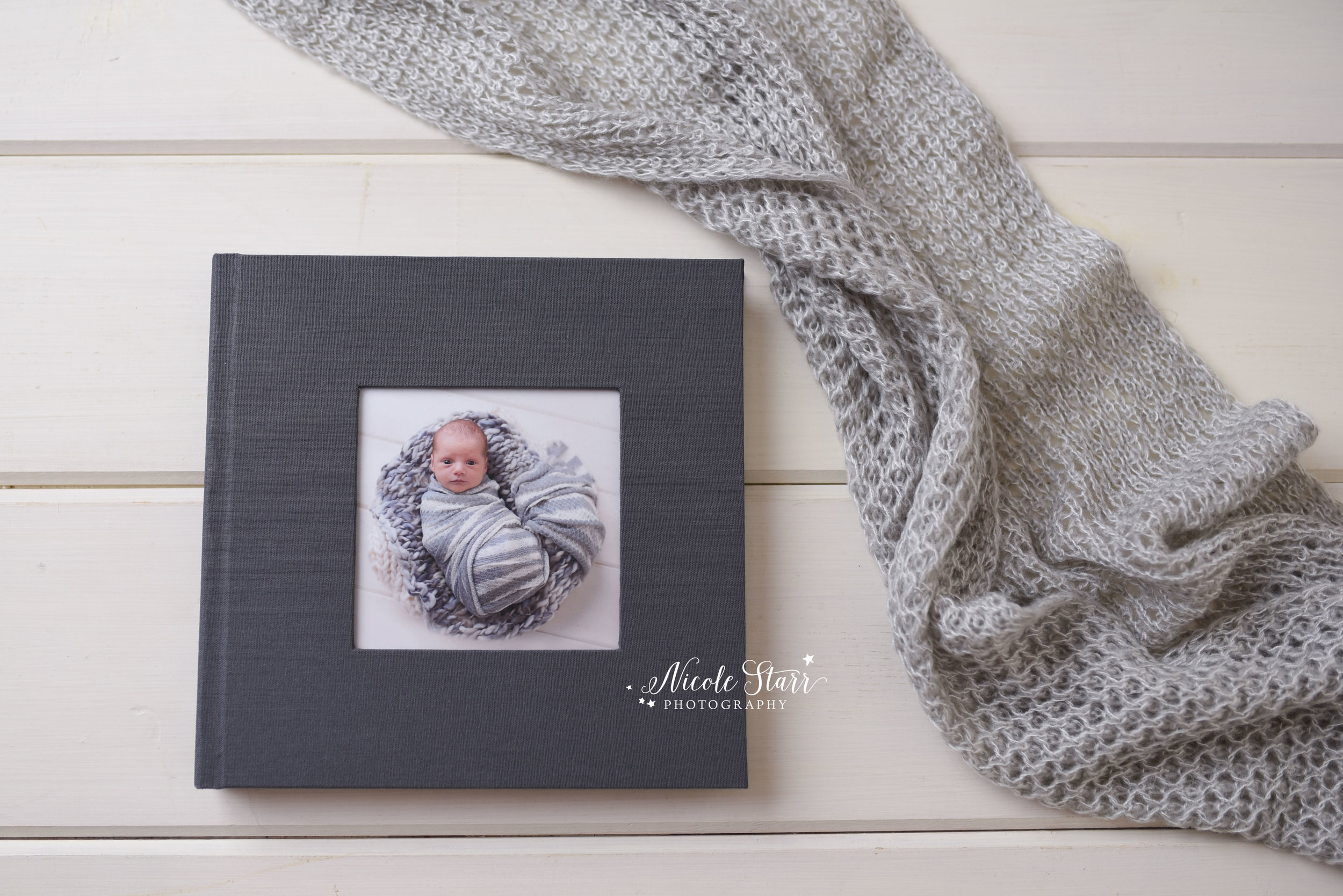 Nicole Starr Photography, fine art album from a studio newborn session
