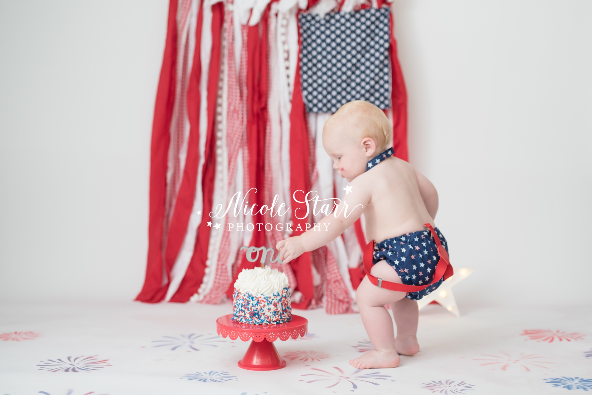 Nicole Starr Photography | Boston MA Cake smash photographer, Saratoga Springs NY cake smash photographer, Delmar NY cake smash photographer, Loudonville NY Cake smash photographer, New York cake smash photographer, cake smash photographer, patriotic cake smash photographer, red, white, and blue cake smash, Fourth of July, Fourth of July cake smash