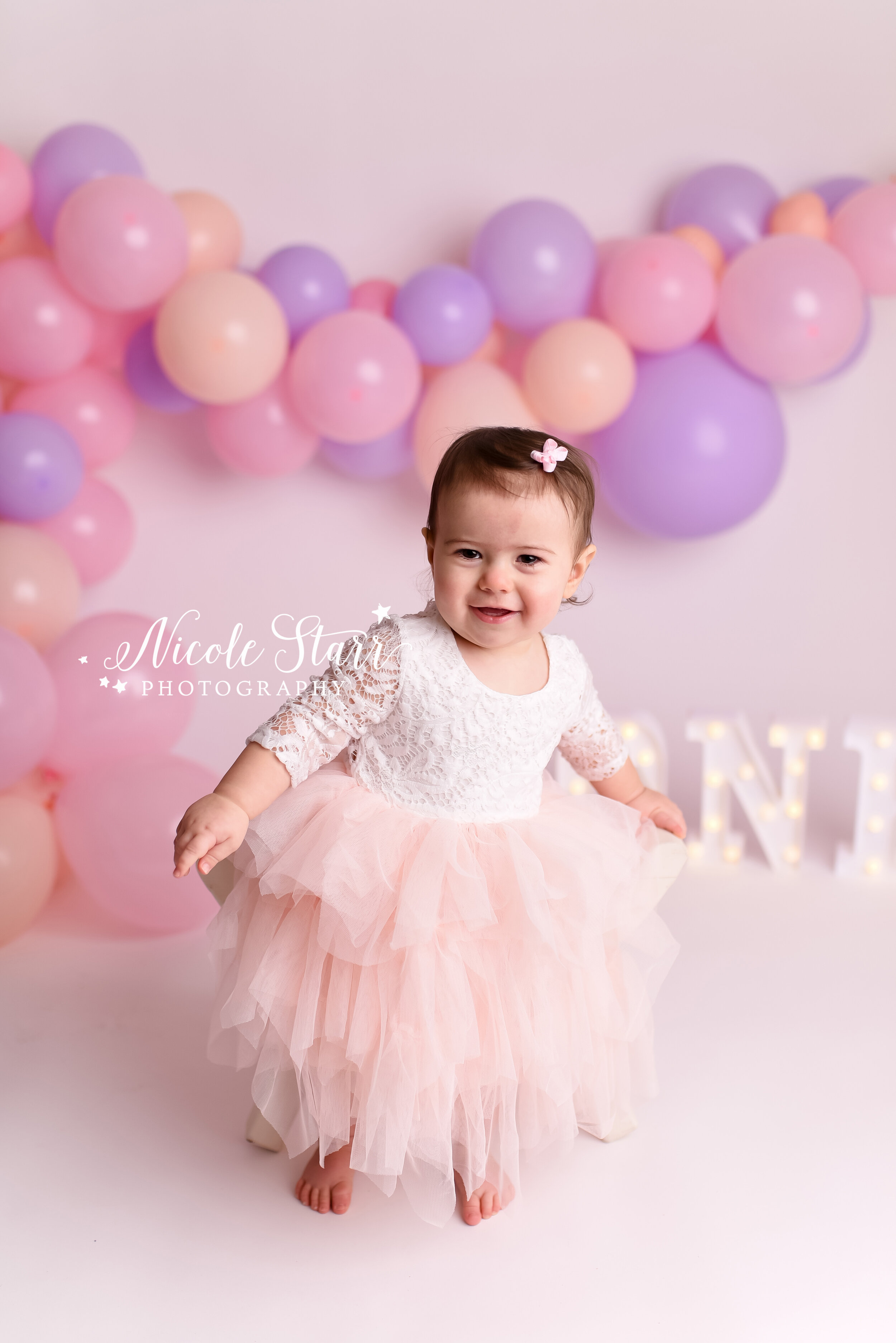 A Pink Lavender Peach Cake Smash With Balloon Garland Saratoga Springs Boston Baby Photographer Nicole Starr Photography