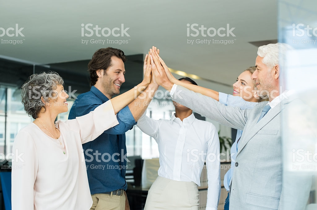 No-one does group-high fives in the office. No one. Source: istock.com