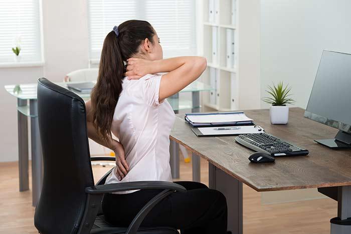 bigstock-Businesswoman-Having-Backpain--95600753.jpg