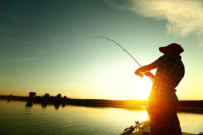 bigstock-Young-man-fishing-on-a-lake-fr-50275337.jpg