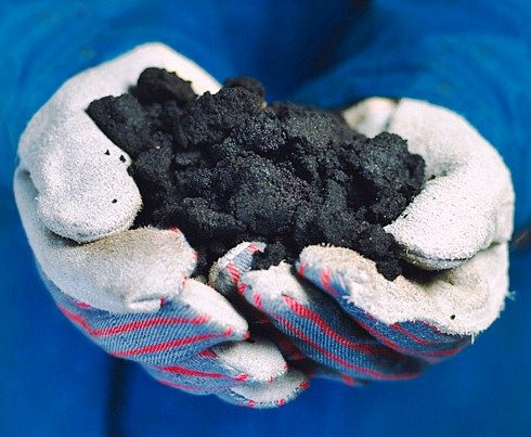 A handful of bitumen from Canada tar sands (Credit: Suncor)