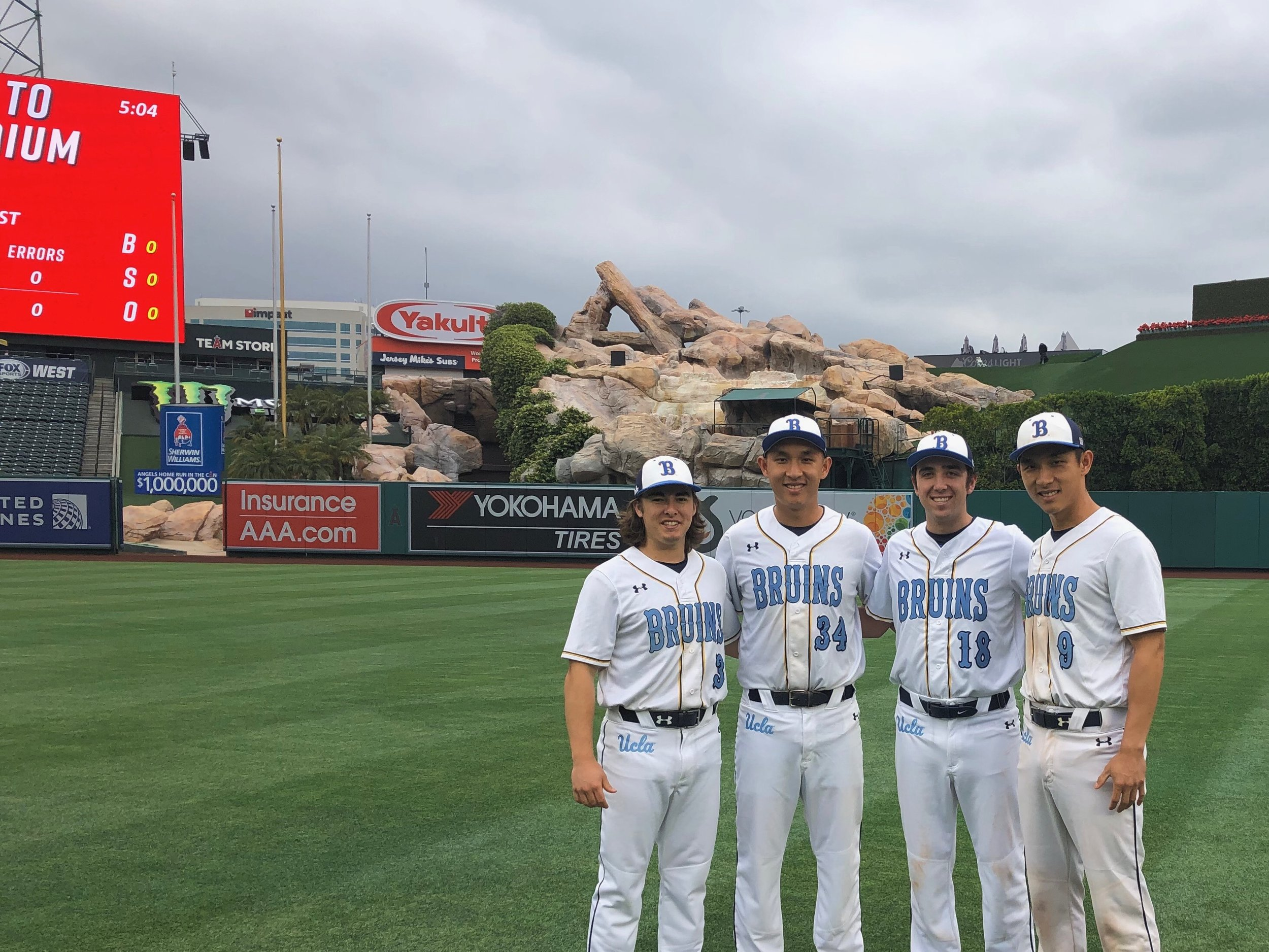 Brothers Mitch, Albert, Jake, and Lawrence playing at Angel Stadium
