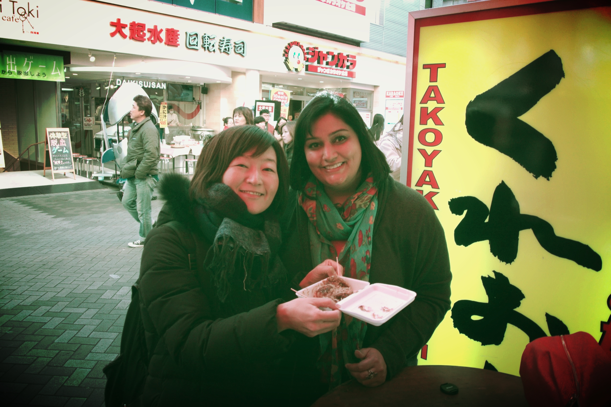 Ryoko introducing my first taste of Takoyaki!  Deliciousness!