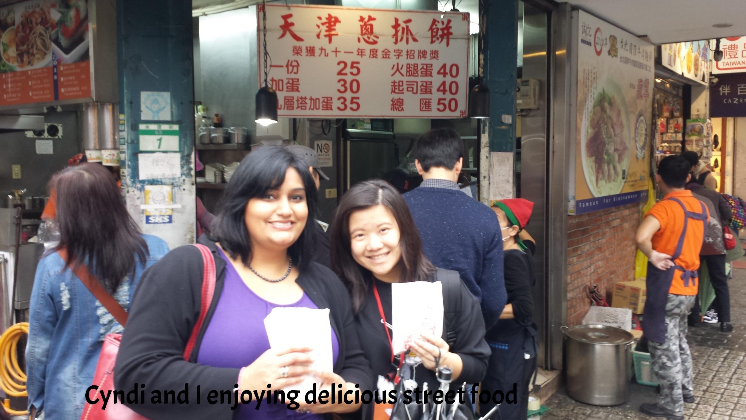 Enjoying street food with Cyndi.jpg