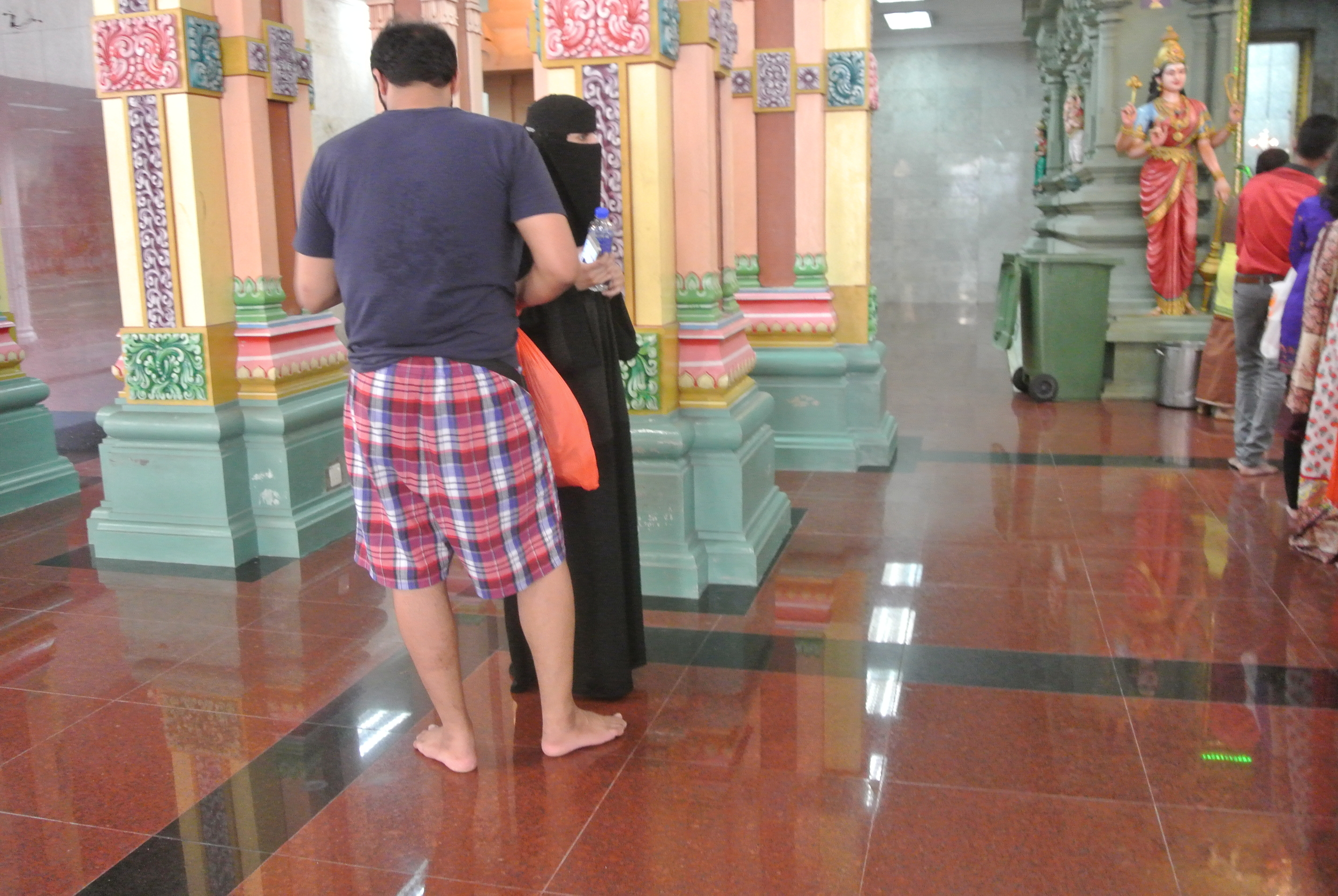 A Muslim couple checking out the scene at a Hindu temple