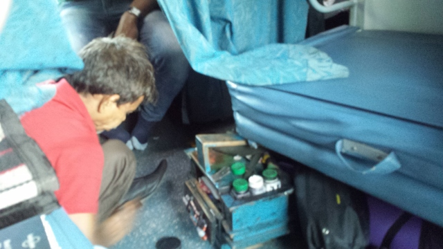 Shoe polisher on train (640x360).jpg