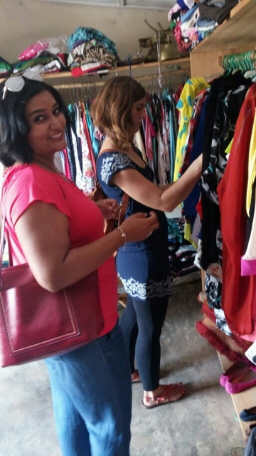 Sheila and I browsing a consignment store for work clothes