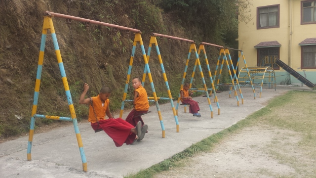 Tibetan Monks in training, they are taking a quick break between science class