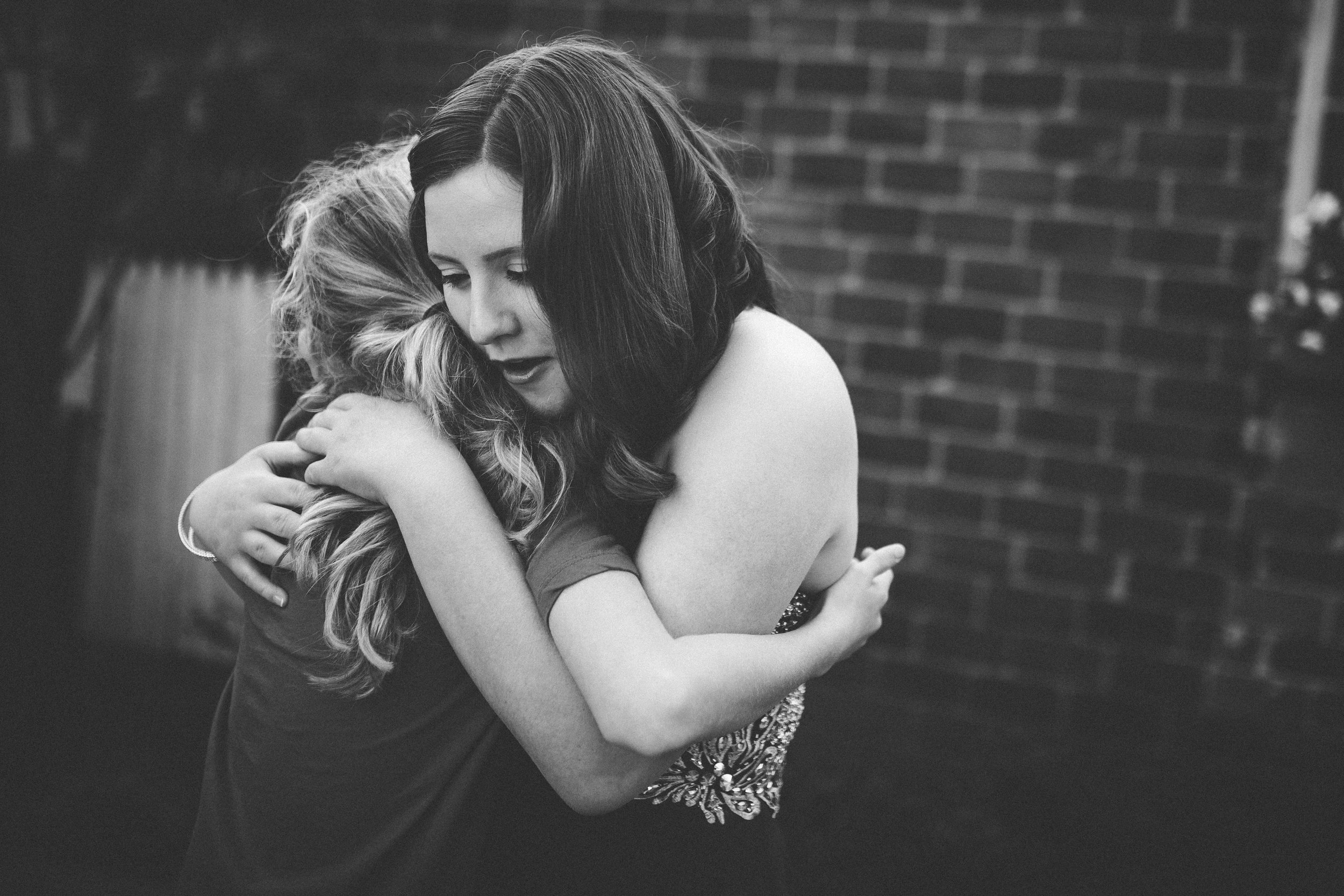 teen girls hugging at prom