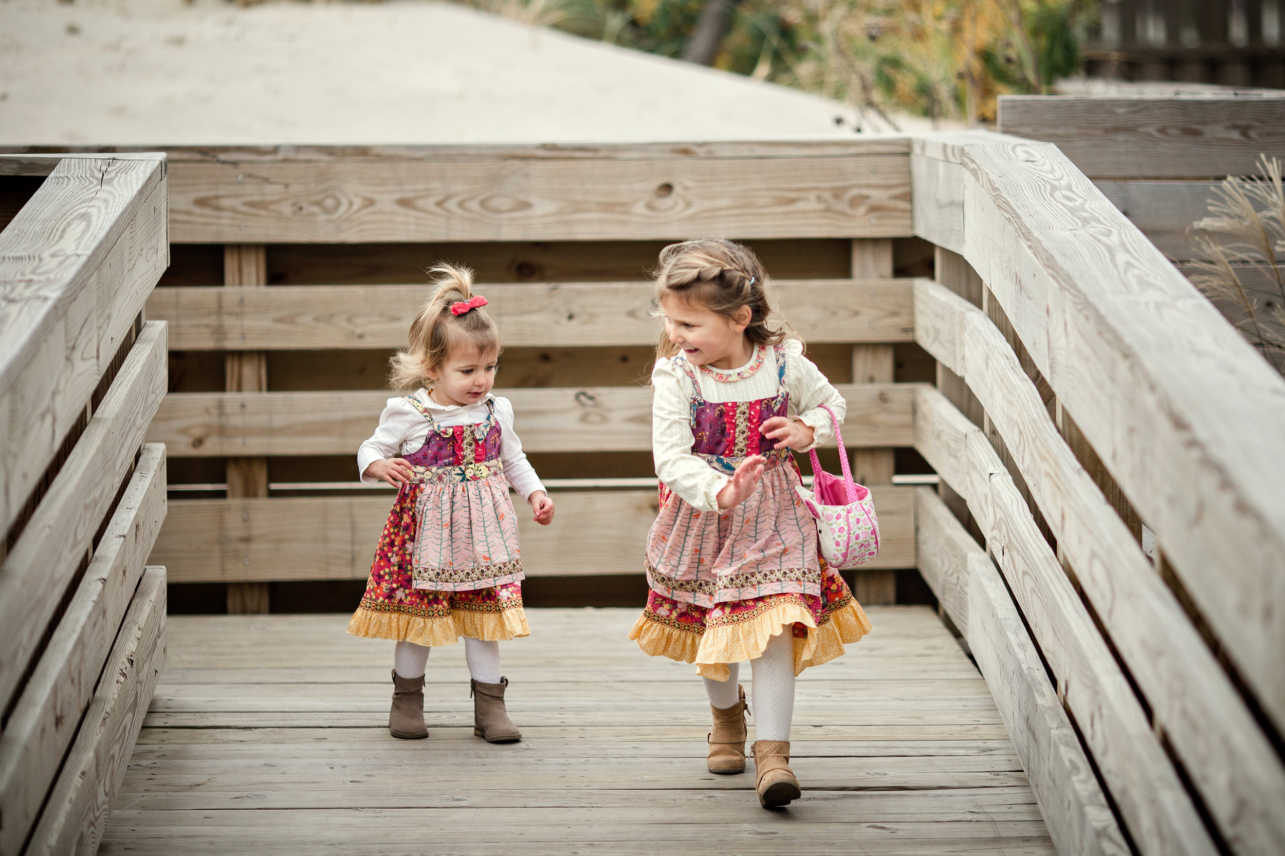 girl in Matilda Jane dresses running on boardwalk