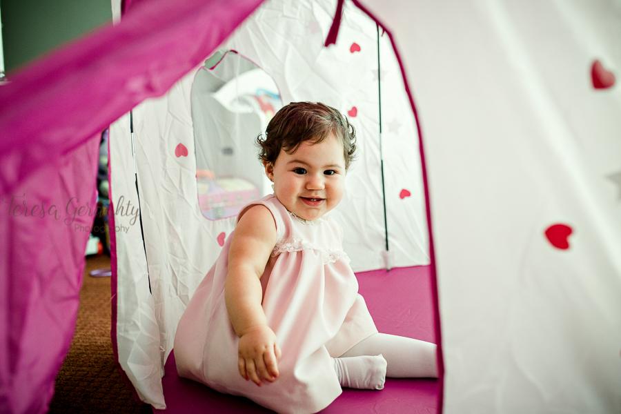 girl in vintage dress in pink tent